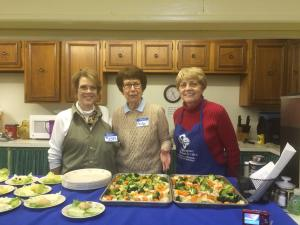 "Image from Floyd County Health Department: Theresa Scott, Becky Derossett, and Bonnie Hale prepare a meal to share with participants of the ""Good and Cheap"" cooking demo event and discuss the philosophy of how to ""eat well - really well – on the strictest of budgets."""